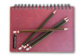 Notebook isolated on the white with pencils. — Stock Photo