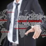 Businessman pushing Social Network world map. — Stock Photo