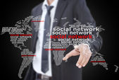 Businessman pushing Social Network world map. — Stock Photo