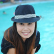 Close up Asian girl with the swimming pool. — Stock Photo