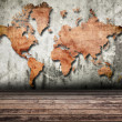 Vintage world map carving on wall texture. — Stock Photo