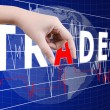 Hand putting Trade word on the stock market graph. — Stock Photo #9704235