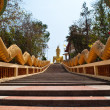 Long stairs to Buddha Statue in Thailand. - Stock Photo