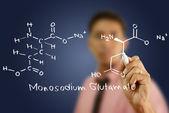 Teacher writing scientific formula on the whiteboard. — Stockfoto