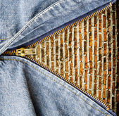 Close up of zipper with grunge wall in blue denim. — Stock Photo