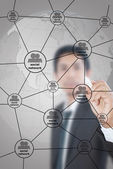Businessman write Social Network diagram. — Stock Photo