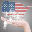 Hand putting Social Network and USA flag. — Stock Photo