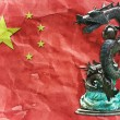 Chinese Dragon statue on Chinese flag with China day. - Stock Photo