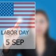 Business lady pushing Labor day. — Stock Photo #9783641