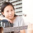 Lady playing classic acoustic guitar. — Stock Photo