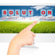 Hand pushing Solution word on monitor screen. - Foto de Stock  
