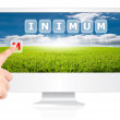 Hand pushing Minimum word on monitor screen. - Stock Photo