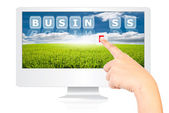 Hand pushing Business word on monitor screen. — Stock Photo
