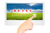 Hand pushing Reject word on monitor screen. — Stock Photo