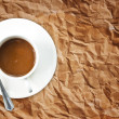 Coffee cup on the vintage paper texture. — Stock Photo