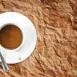 Coffee cup on the vintage paper texture. — Stock Photo #9808768