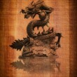Chinese style dragon statue on the wood texture. - Foto de Stock