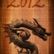 Chinese style dragon statue on the wood texture. - Stock fotografie