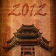 Chinese temple on the wood texture for New Year 2012. - Foto de Stock