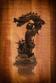 Chinese style dragon statue on the wood texture. — Stock Photo