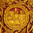Thailand golden statue on the temple wall. — Stock Photo