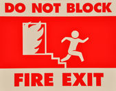 Do not block fire exit sign — Stock Photo