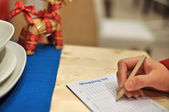 Writing shopping list for xmas season — Stok fotoğraf