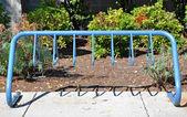 Empty metal industrial blue bike rack — Stock Photo