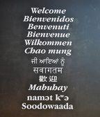 Multi-language Wellcome board — Stock Photo