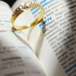 ストック写真: Wedding ring casting heart onto marry word