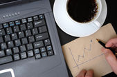 Man drawing business finance graphs — Stock Photo