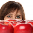 Stock Photo: Girl behind red apples