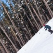 Stock Photo: Skier carving down from steep slope