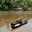 Fishing boats in tropical river near indian village. Goa - Stock Photo