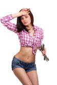 Girl with wrenches in their hands — Stock Photo