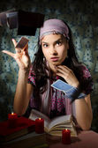 Fortune teller is throwing the cards — Stock Photo