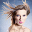 Fashion portrait of beautiful woman with streaming hair — Stock Photo