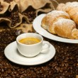 Coffee cup with croissant — Stock Photo