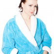 Young woman in blue bathrobe against white background — Stock Photo