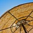 Low view of parasol against blue sky — Stock Photo