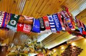Scarves of football clubs and car license plates — Stock Photo