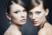 Two beautiful woman with bright trendy makeup and jewelry — Stock Photo
