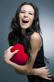 Valentines Day. Beautiful smiling woman with a gift — Stock Photo