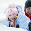 Portrait of children playing in the snow in the winter — Stock Photo #9772957