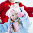 Portrait of children playing in the snow in the winter — Stock Photo #9772968