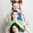 Portrait of a beautiful family: parents and children play together — Stock Photo