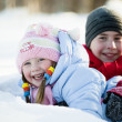 Portrait of children playing in the snow in the winter — Stock Photo #9777002