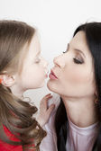 Portrait of a beautiful mother and daughter in his arms — Stock Photo
