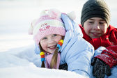 Portrait of children playing in the snow in the winter — Stock Photo