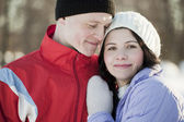 Portrait of happy couple in the winter — Stock Photo